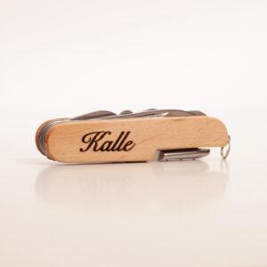 fickkniv med trähandtag och gravyr, personlig present